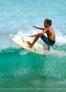 Grom surfing North Shore of Kauai
