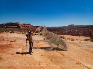 Lad petting dinosaur