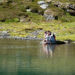 Mom with son on glacier lake.