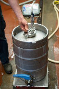 Weighing beer keg