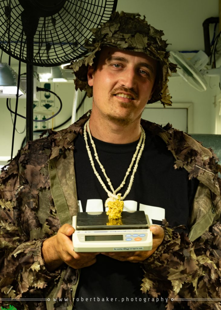 Man holding cannabis scale